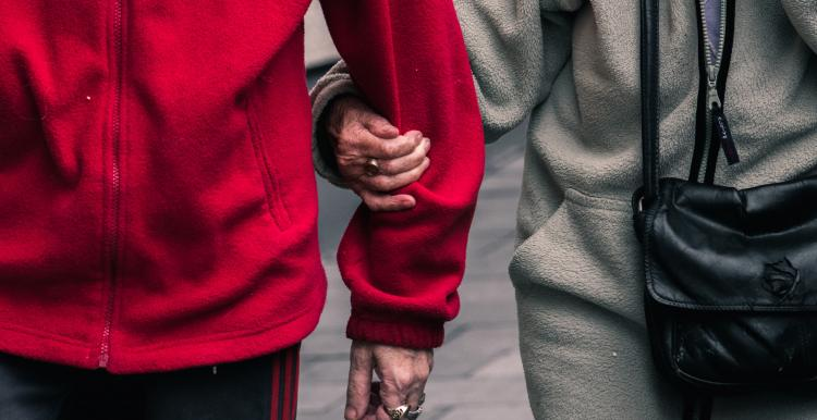 two people walking hand in arm