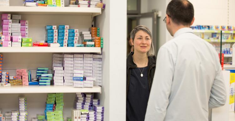 woman talking to male pharmacist