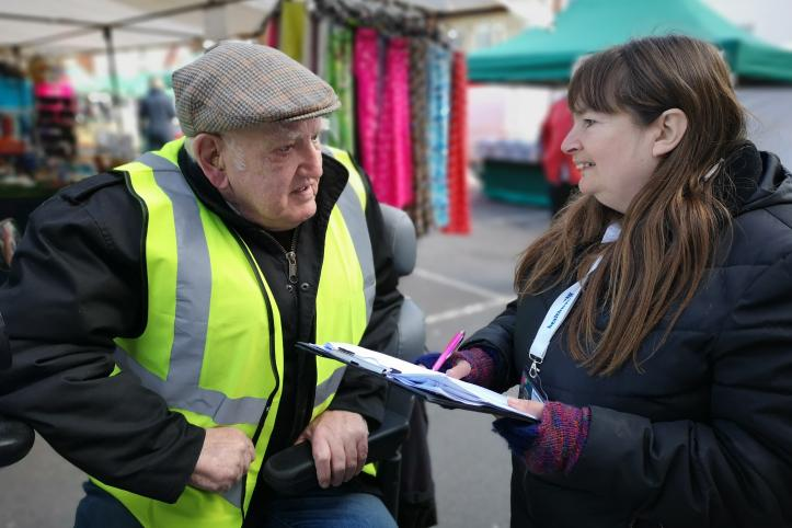 Healthwatch talking to man at market