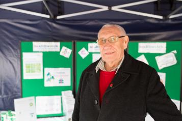 male volunteer promoting healthwatch at an event
