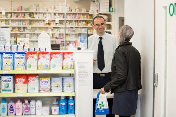 woman talking to male pharmacist