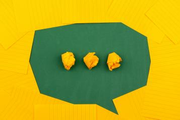 yellow and green paper speech bubble
