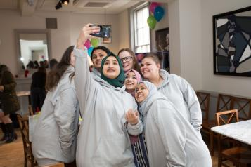 young volunteers taking a group selfie